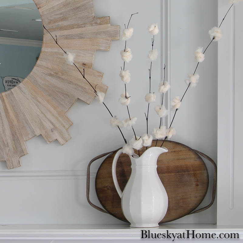 DIY cherry blossom flowers in white pitcher on mantel