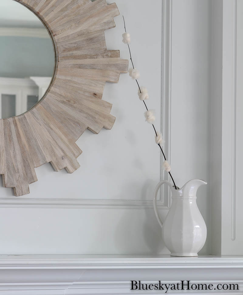 One DIY cherry blossom flowers in white pitcher on mantel