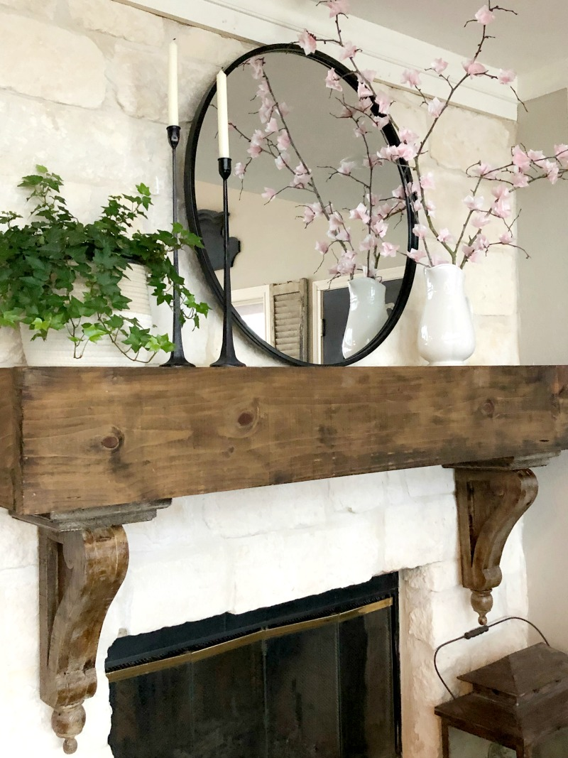 Spring mantel with mirror and DIY cherry blossom flowers