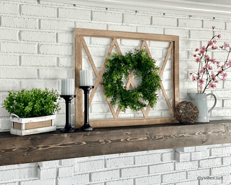 spring mantel with frame, wreath, cherry blossoms, candles