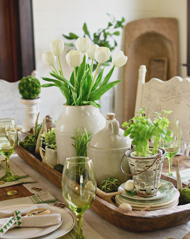 tabletop with white pitcher and greenery