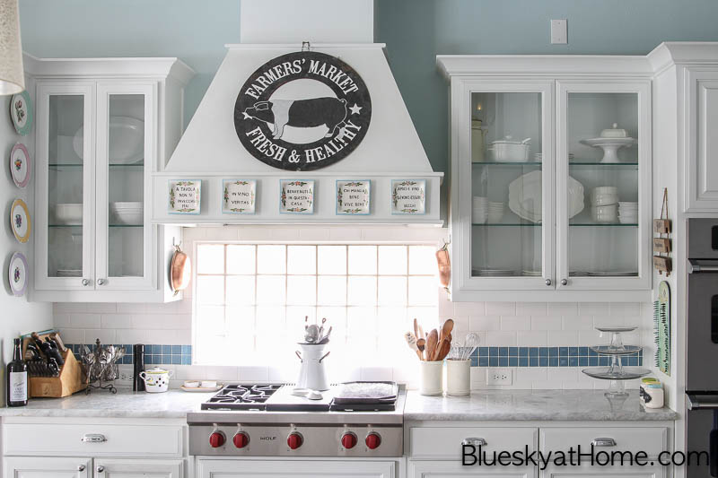 white kitchen with focal point stove and cabinets