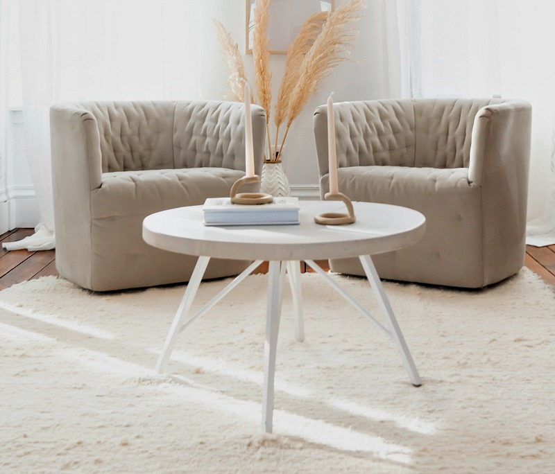 white rug and two chairs