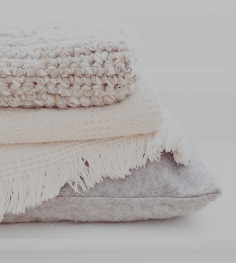 stack of winter blankets and pillow