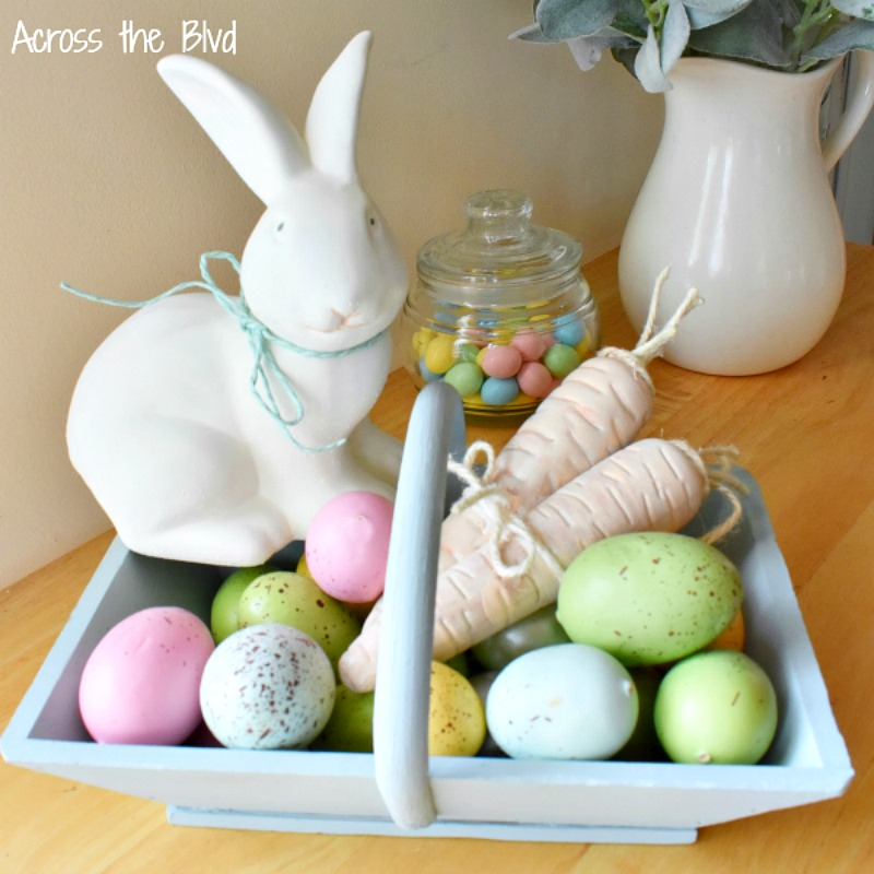 painted Easter eggs in wood basket and Easter bunny