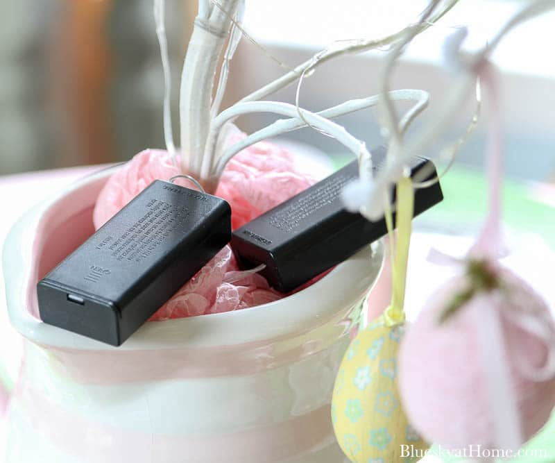 batteries on pink and white pitcher