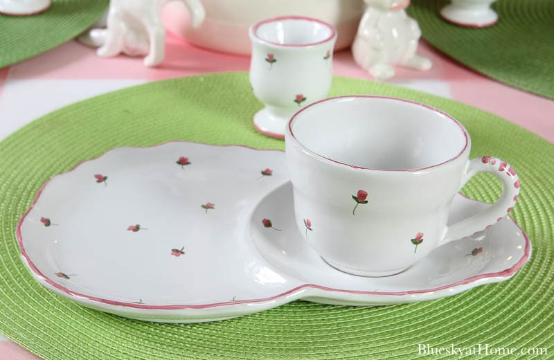 white plate and white cup with pink flowers