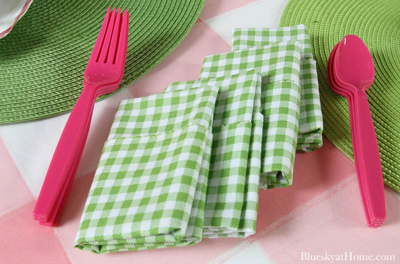 green and white check folded napkins