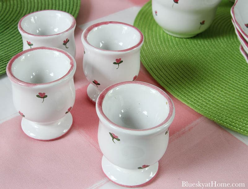 4 egg cups with pink flowers