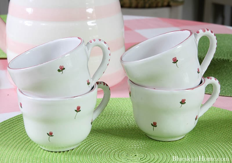 4 cups with pink flowers