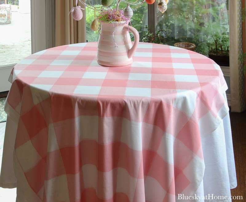 pink check tablecloth with pink and white pitcher