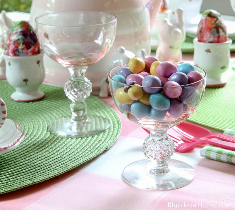 pastel candies in pink glass