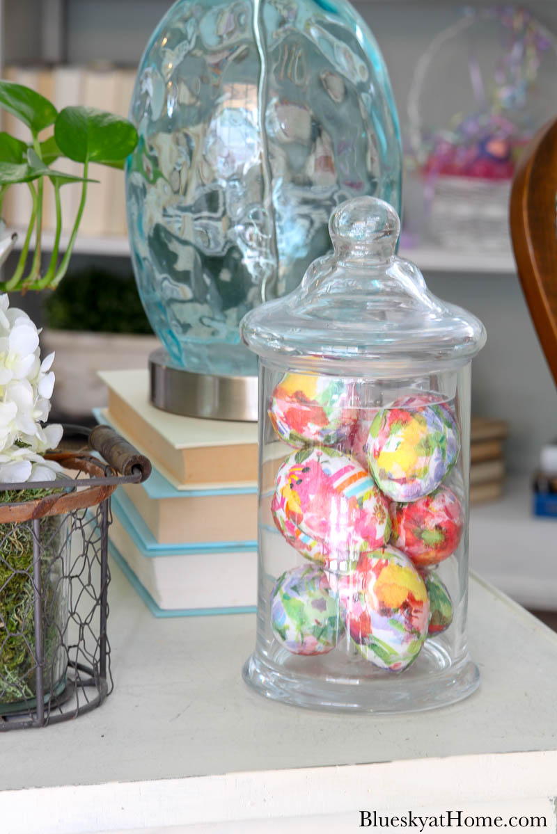 floral decorated Easter eggs in glass jar