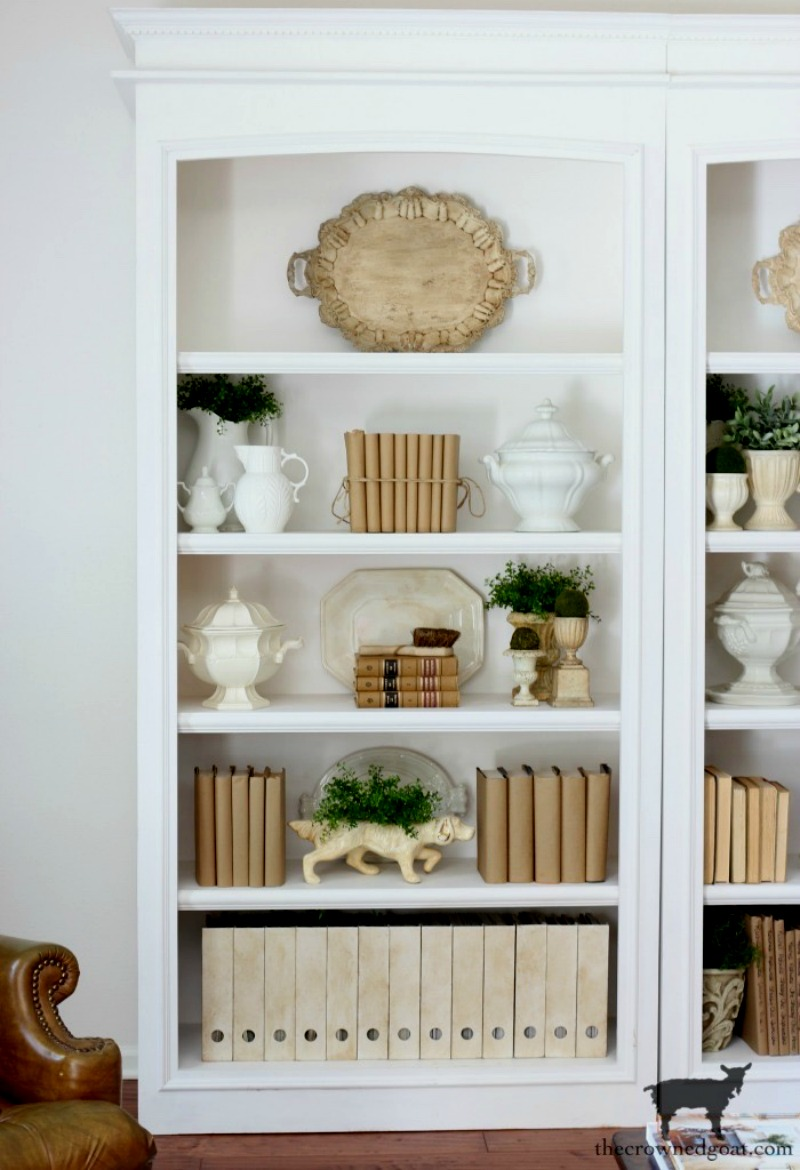 bookcases with books, tray, white ironstone, greenery