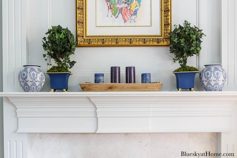 blue painted planter and blue vase on mantel