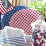 Memorial Day decorations with red check plates and flags