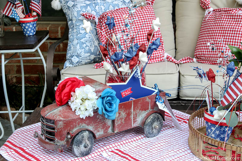 vintage red truck with 4th of July decorations