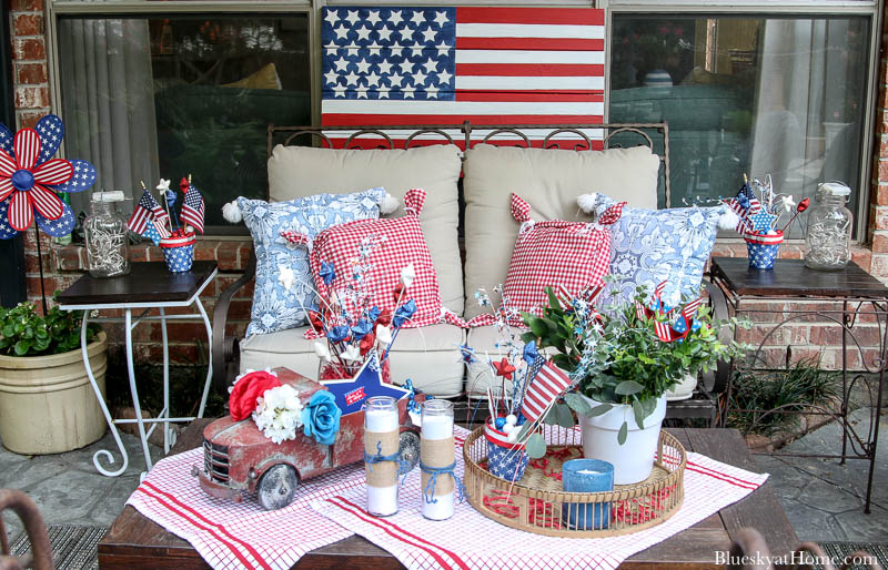 patio loveseat with red and bue pillows and 4th of July decorations