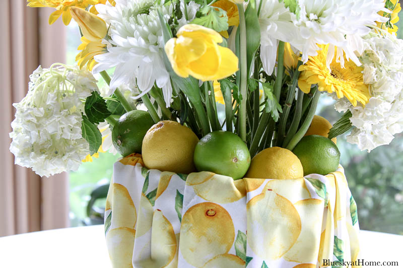 yellow and white flowers in summer centerpiece