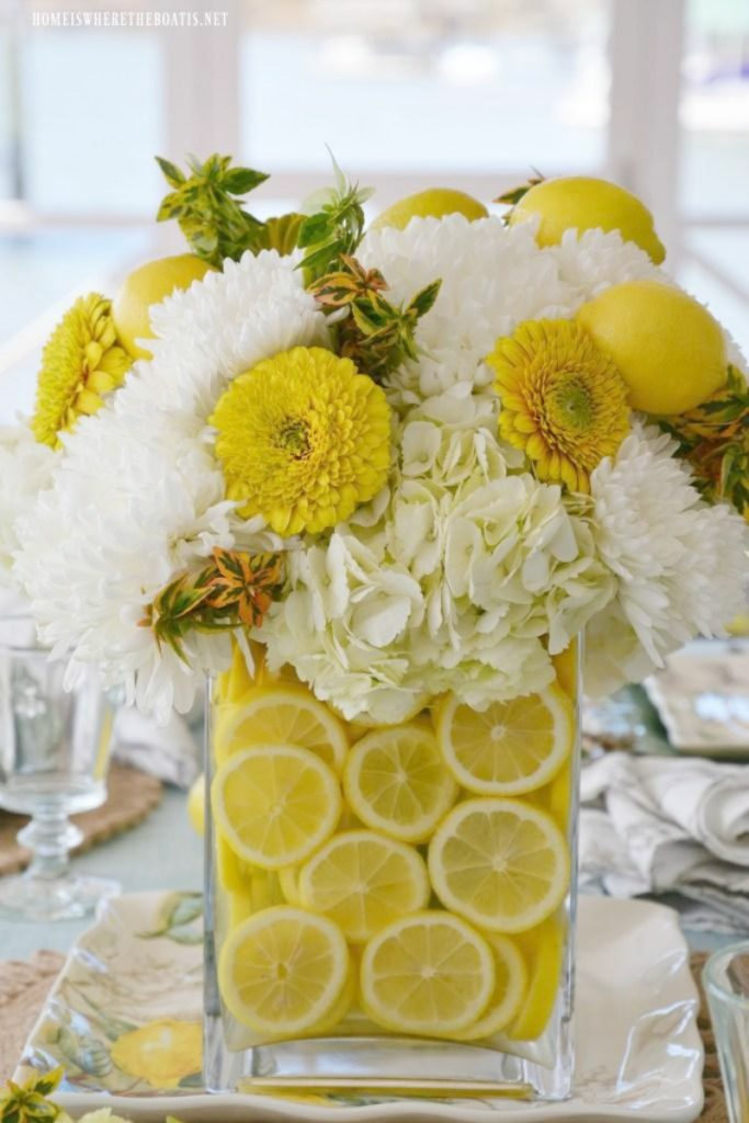 clear vase with lemons
