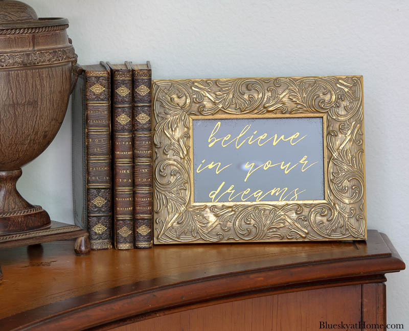 gold stencil on glass in gold frame