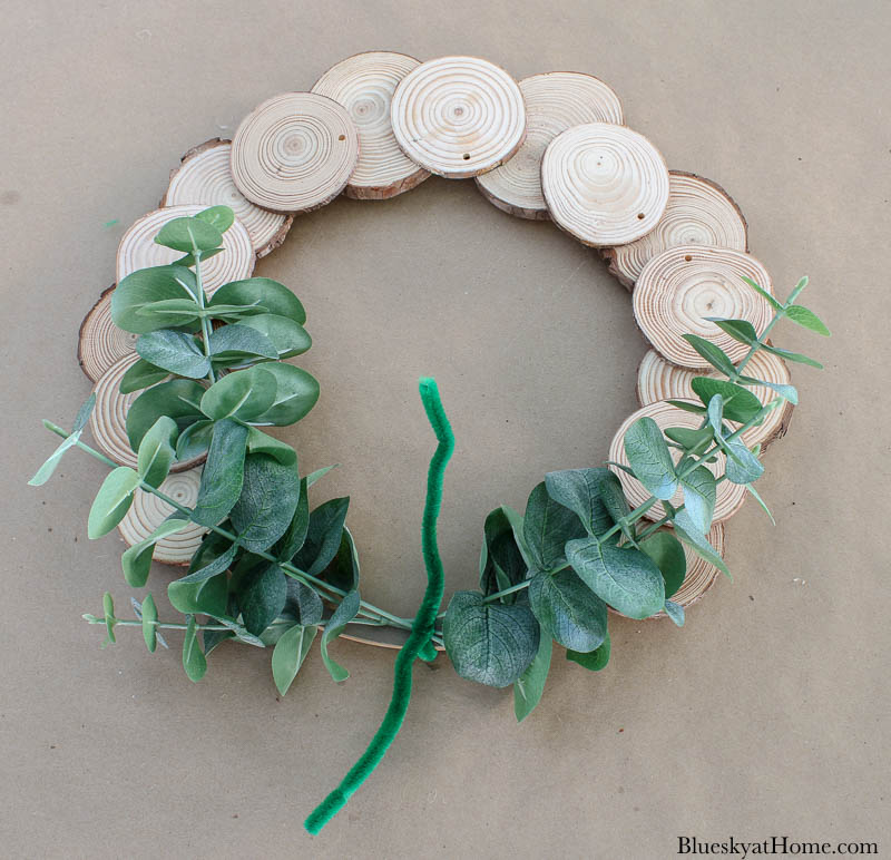 wood slice wreath with faux greenery