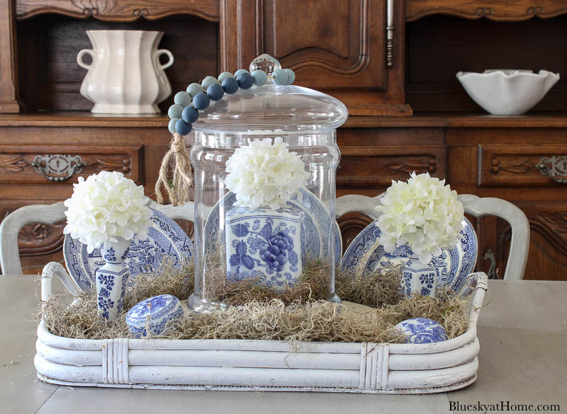 blue and white ginger jar inside cloche