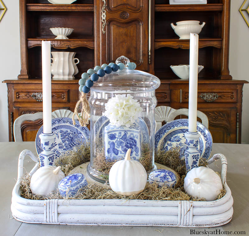 blue and white fall vignette with candles