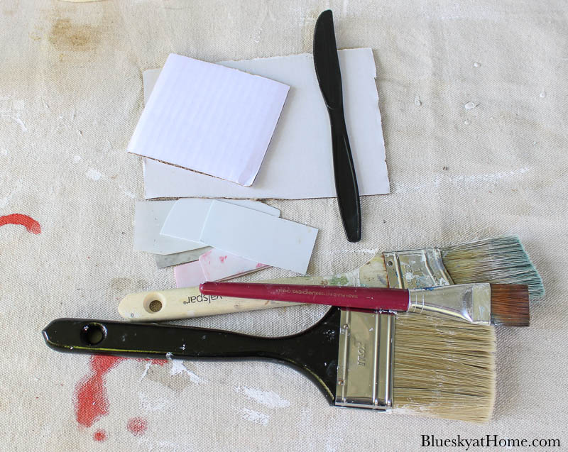table with paint supplies
