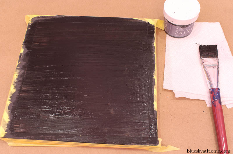 painting black frame for black and white fall entry