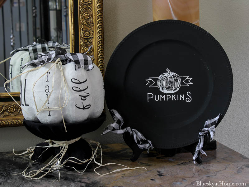 black and white fall entry round sign and pumpkins