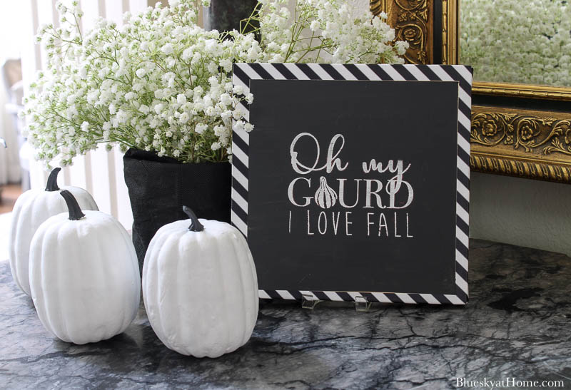 black and white fall entry sign and pumpkins