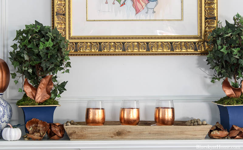 copper candle holdrs on fall decorated mantel