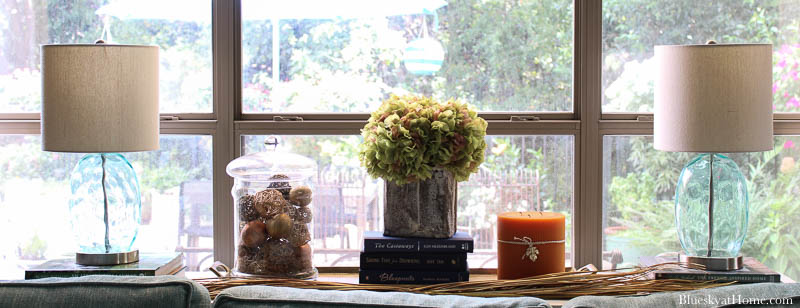 dried hydrangeas in grain scoop on fall decorated table