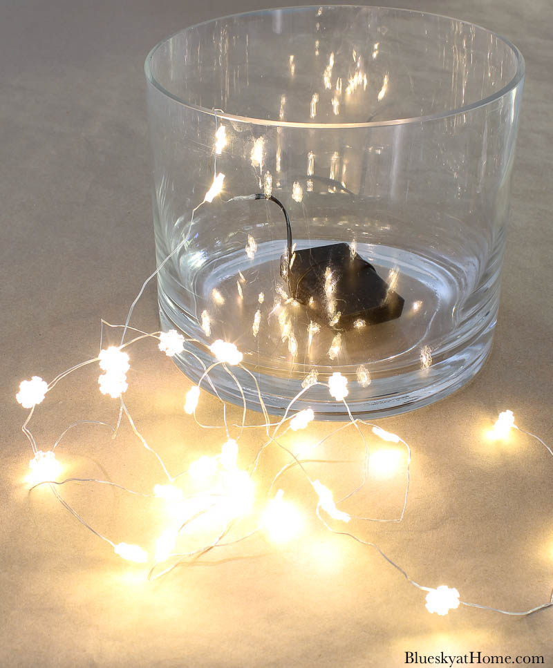 galss vase with lighted Christmas lights