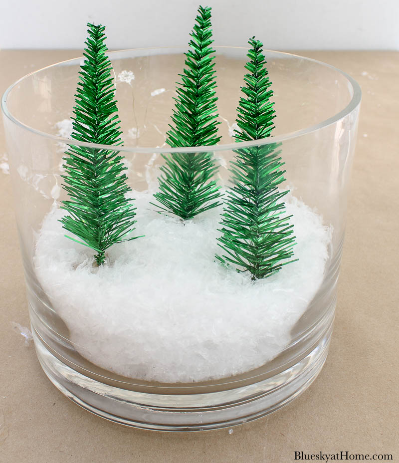 3 Christmas tres in glass vase with snow
