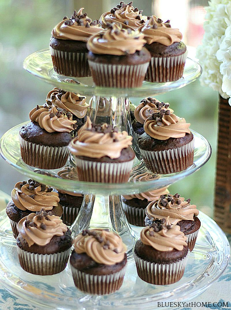 chocolate pumpkin cupcakes on a tiered cake stand