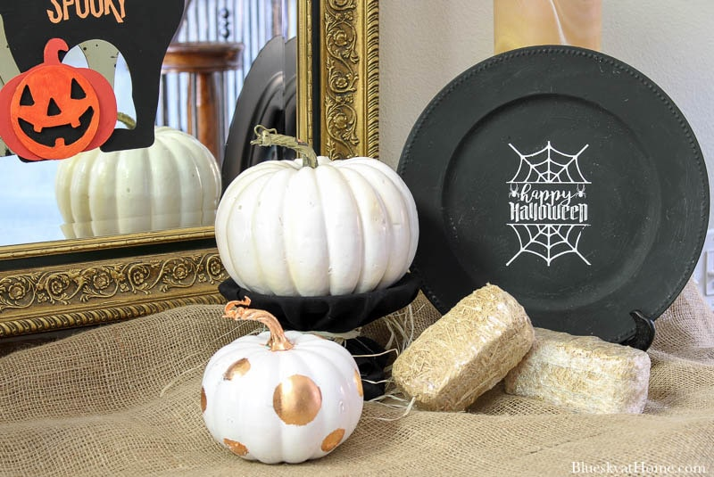 Halloween Decorations for Your Entry with black charger and white pumpkin