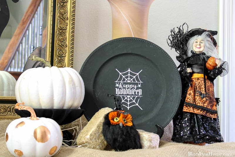 Halloween Decorations for Your Entry with black charger and white pumpkin and witch