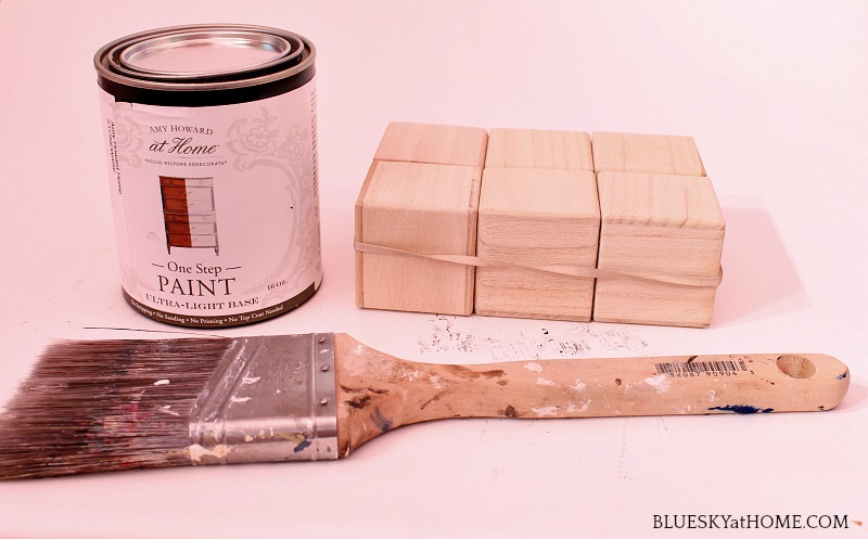wood blocks, paint can and paint brush
