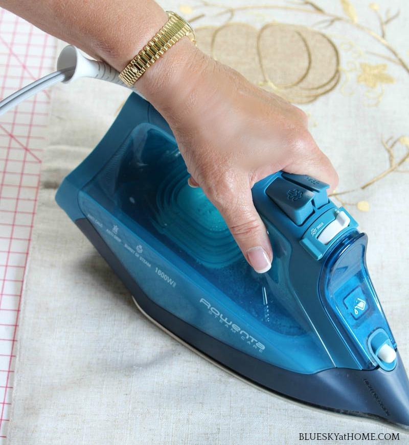 ironing a pumpkin pillow cover