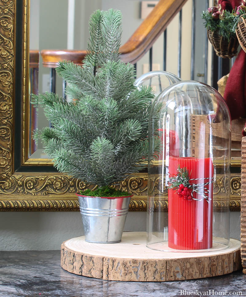 red candle and faux Christmas tree
