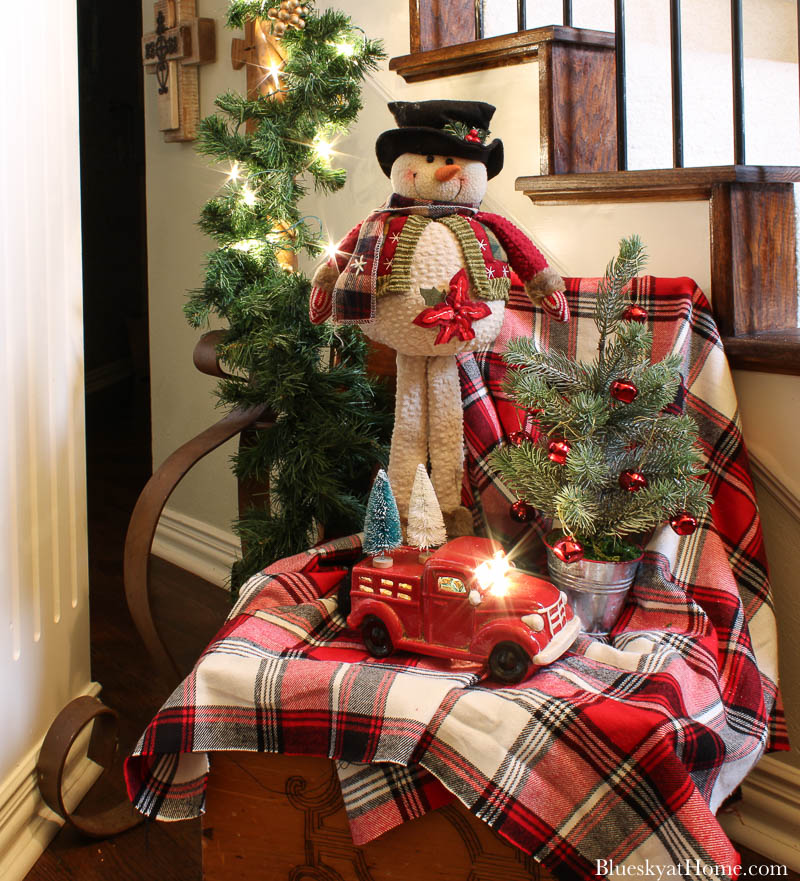 red plaid blanket with snowman and red truck