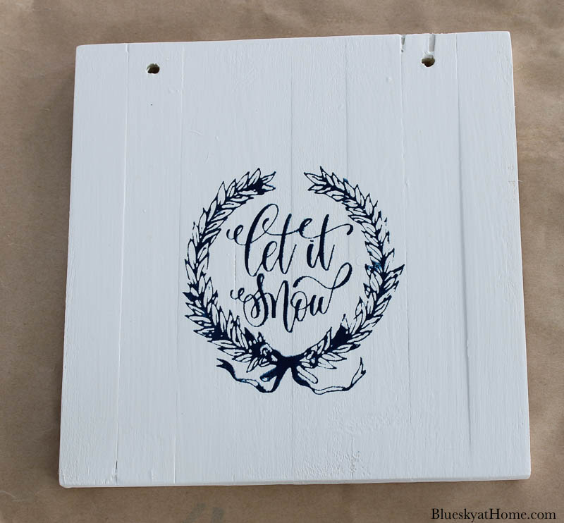 stencil and white painted square wood sign