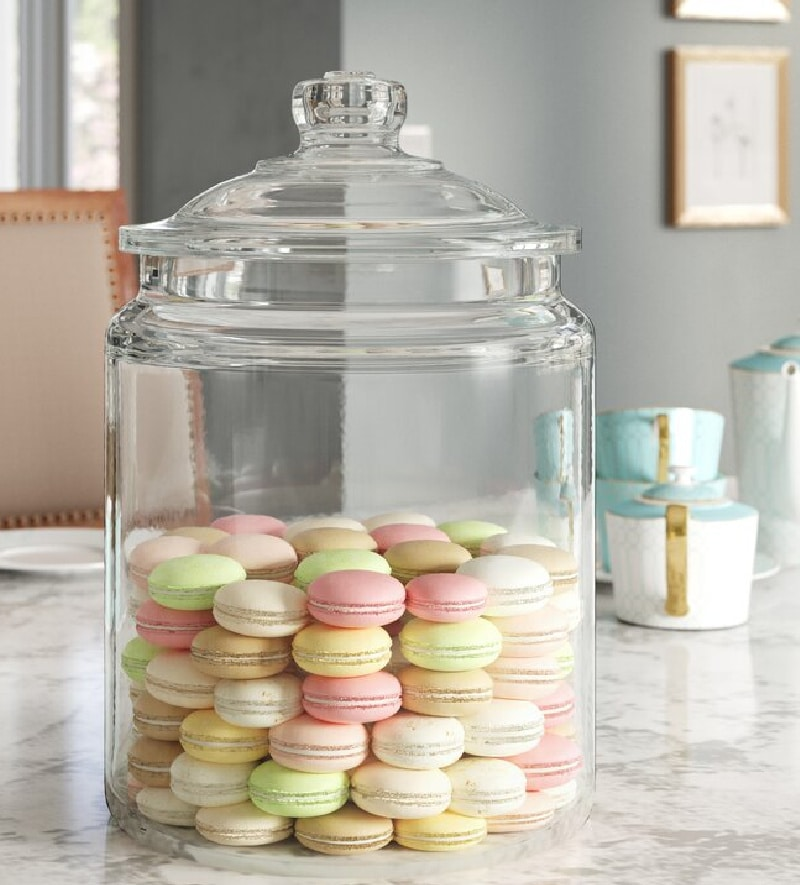 larage apothecary jar filled with pastel cookies