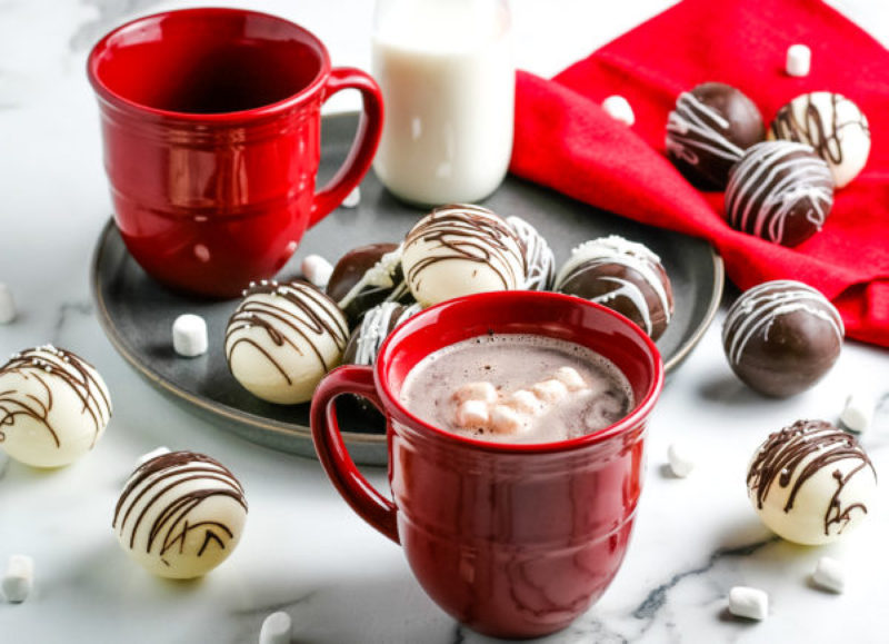 hot chocolate bombs and red mugs