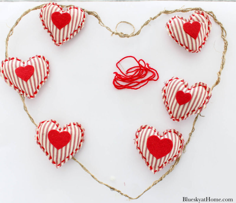 Valentine wreath with red fabric hearts