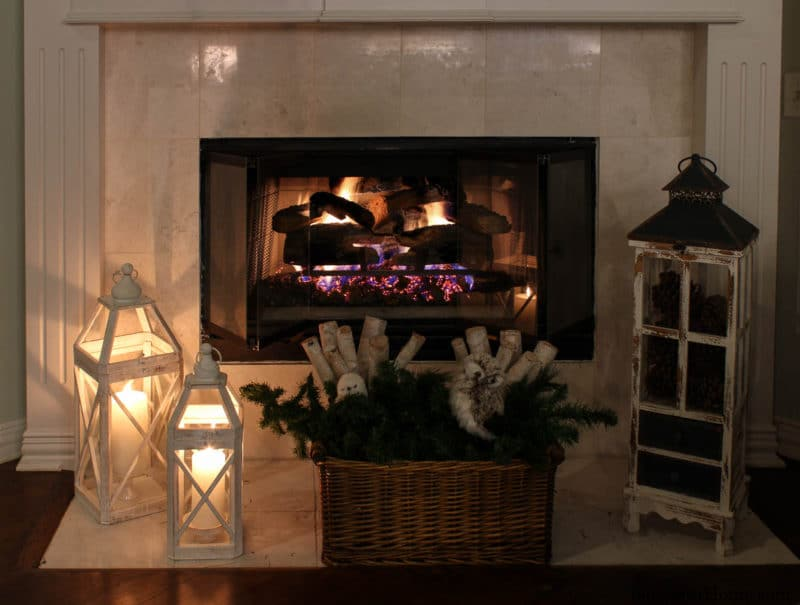 fireplace with white lanterns