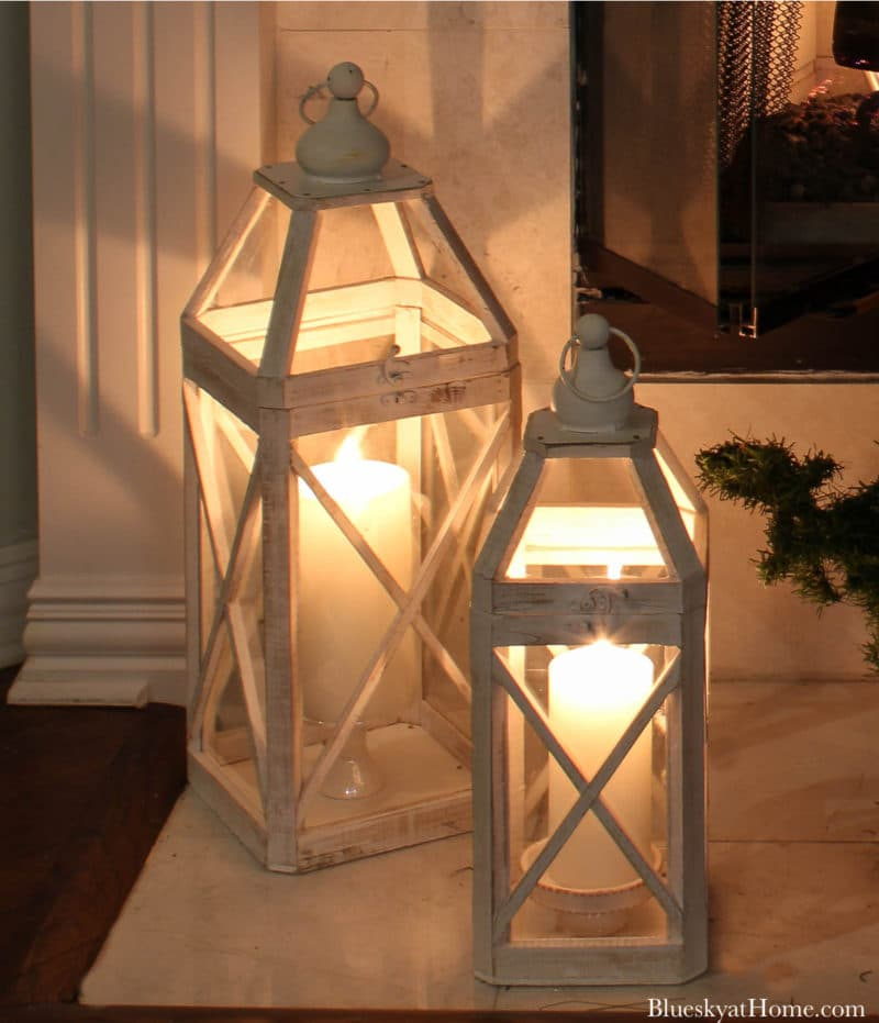 white lanterns with candles