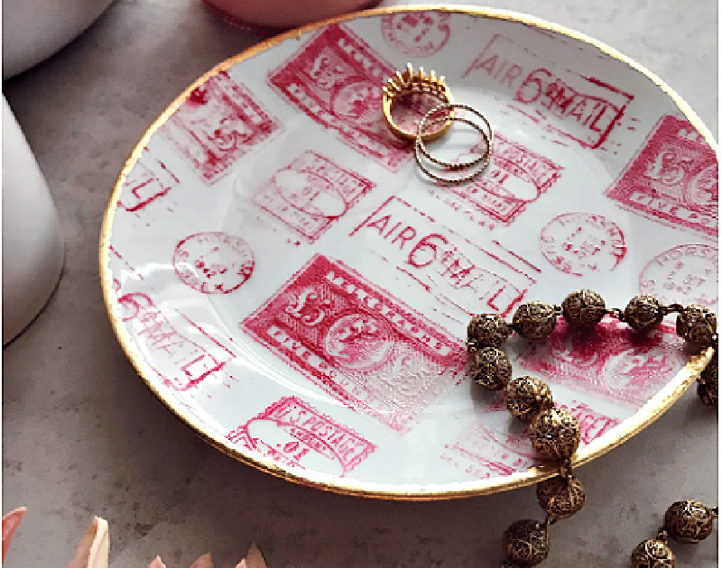 pink stenciled tray with jewelry